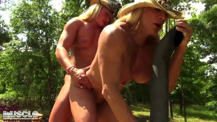 2 female bodybuidlers fuck outside on a backhow