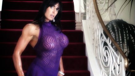 female muscle mom Elise Penn in purple lingerie.