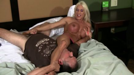 female muscle pornstar scissoring a guy and squeezing his cock