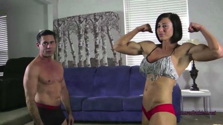 female bodybuilder goddess rapture flexing before wrestling match