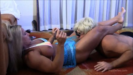 big female bodybuilder scissoring a guys head