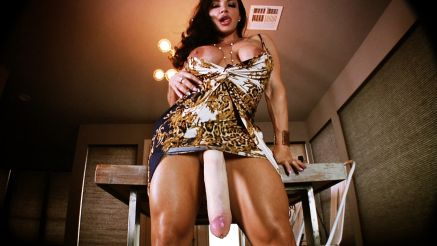 female bodybuilder showing off her massive huge cock