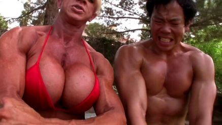 big muscular woman beats up man