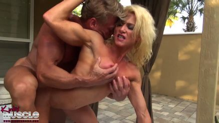 muscle MILF bodybuilder Mandy Foxx naked giving a guy a handjob