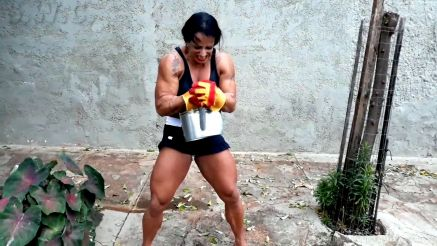 female bodybuilder showing off her strength