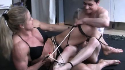 female wrestling with rope bondage