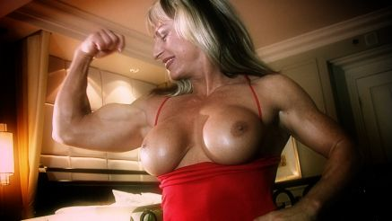 Gina Jones flexing in a red dress