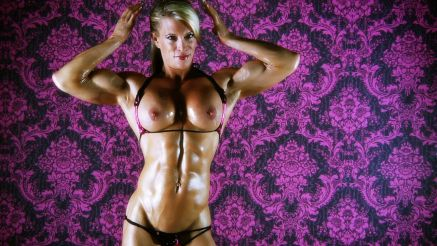 Ginger Martin flexing her thick pec muscle.