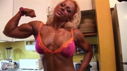 female bodybuilder Dorothy Trojanowicz flexing biceps