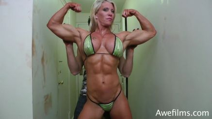 Muscle MILF Ginger Martin flexing her big arms