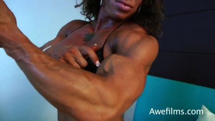 female bodybuilder Jennifer Kennedy showing off huge biceps