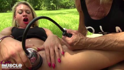 female bodybuilder pumping her big clit