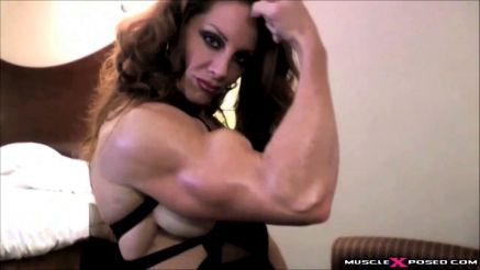 female bodybuilder Ironfirei flexing massive biceps