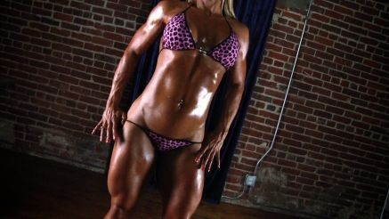 female bodybuilder Jill Jaxen covered in oil.