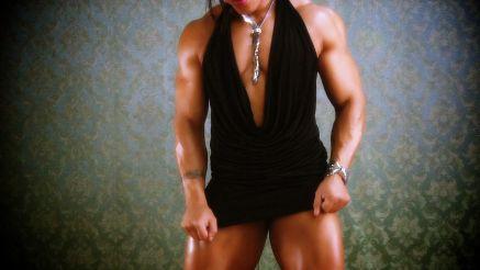 Karen Garrett amazing female muscle in a black dress.