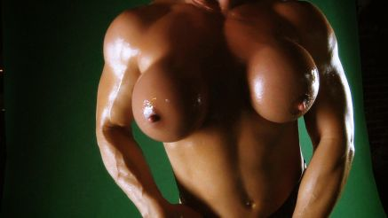 Kathy Connors mature muscle oiled up big round fake boobs.