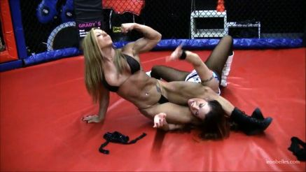 female bodybuilder dominating in wrestling ring