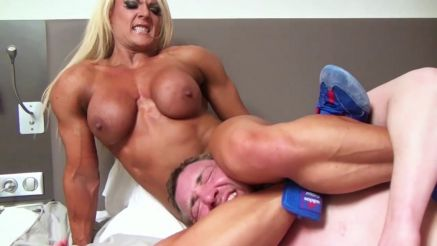 nude female bodybuilder Lisa Cross dominating a guy