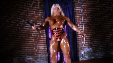 Lisa Cross topless and dripping with oil muscle girl