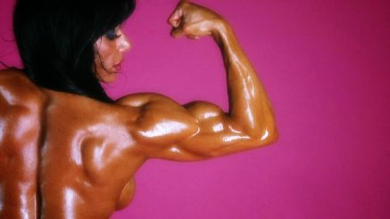 muscle MILF Marina Lopez covered in oil bicep flex porn