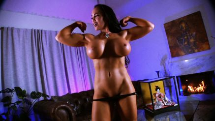 topless fit girl with big tits flexing her biceps