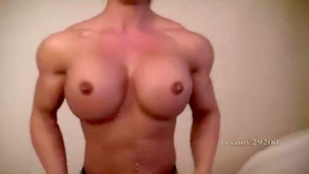 topless female bodybuilder massive shoulders