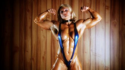 female bodybuilder Brigita Brezovac flexing her biceps
