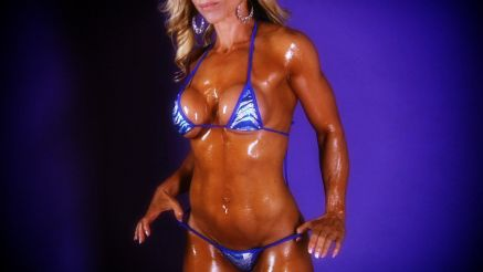 hot muscle MILF covered in oil