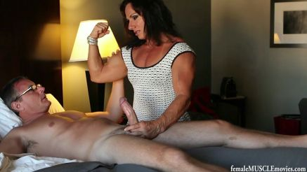 muscle milf stroking a hhard cock and flexing her bicep