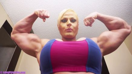Nuriye Evans busty and fit female bodybuilder flexing huge biceps