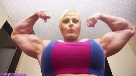 Nuriye Evans busty and fit female bodybuilder flexing huge biceps