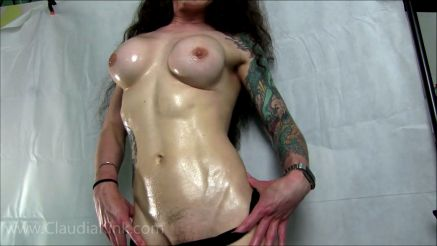 fit girl with oil on her perky fake boobs