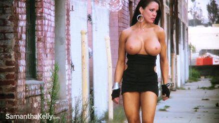 Samantha Kelly walking topless in public.