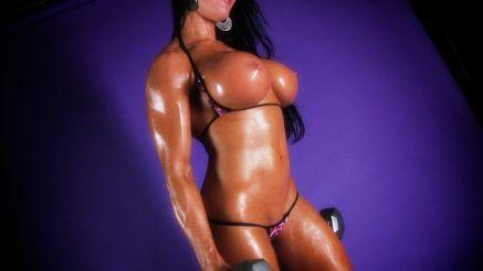 Amazing shot of busty fitness model Samantha Kelly topless.