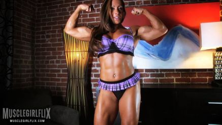 female bodybuilder monica martin flexing biceps