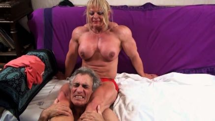 massive muscular woman scissoring a guys head