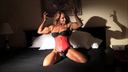 female bodybuilder flexing massive biceps