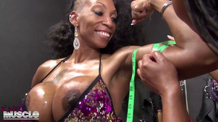 CoCo Crush measuring her biceps