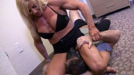 female bodybuilder Laura Carolan sits on a guys face