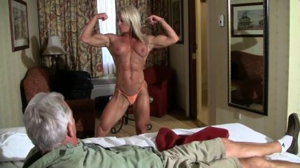 Ginger Martin showing off her muscular body for a guy