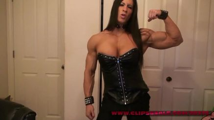 muscle girl pornstar Angela Salvagno flexing her big bicep
