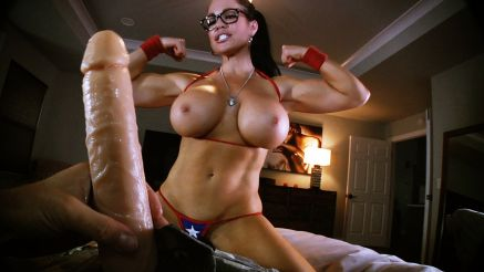 xxx supergirl flexing biceps for a big cock