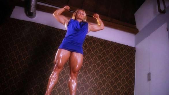 female bodybuilder with massive legs in a blue dress
