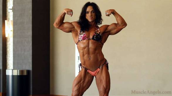 female bodybuilder flexing big biceps