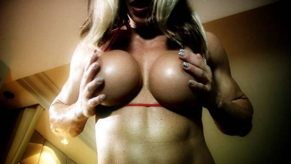 muscle MILF showing off her muscle and tits