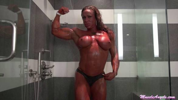 female bodybuilder flexing in the shower