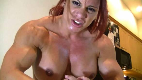 female bodybuilder flexing her huge traps.