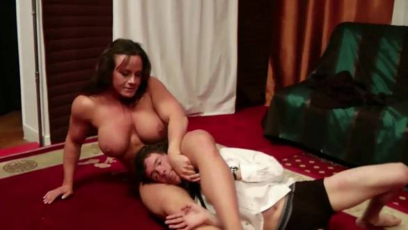 female bodybuilder dominating a guy with her muscle