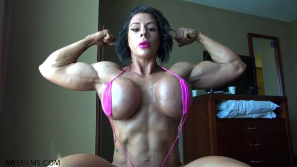 girl with huge fake tits flexing her biceps