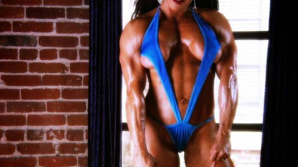 female bodybuilder MILF pec flex